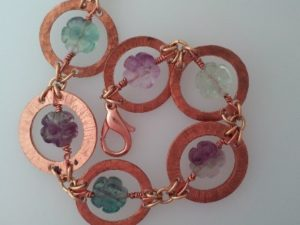 Learn basic jewelry techniques such as texturing, making your own jump rings, wire wrapping beads and more as you create this Copper Circles and Beads ...